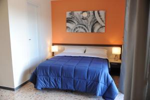 Letto o letti in una camera di Dimore Le Lucane
