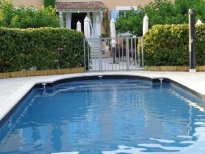 The swimming pool at or near Canto Cigalo