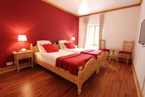 A bed or beds in a room at Hôtel de Ville