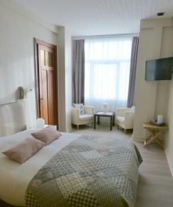Ein Bett oder Betten in einem Zimmer der Unterkunft Hotel Georges