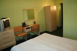 A bed or beds in a room at Guest House Jāņkrasti