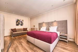 Ein Bett oder Betten in einem Zimmer der Unterkunft Konvikt Apartment