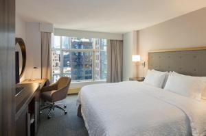 A bed or beds in a room at Hampton Inn Manhattan Chelsea