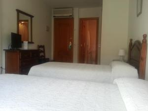 A bed or beds in a room at Hotel La Morena