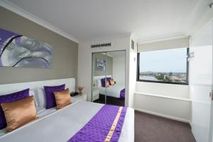 A bed or beds in a room at Park Regis North Quay