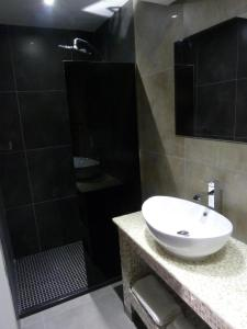 A bathroom at Achilleos City Hotel