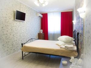 Кровать или кровати в номере Отель «7 Звезд»