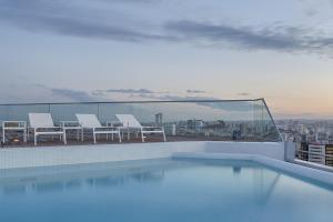 The swimming pool at or near Four Points by Sheraton Oran