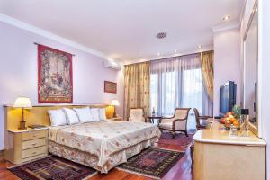 Ένα ή περισσότερα κρεβάτια σε δωμάτιο στο Minerva Premier Hotel