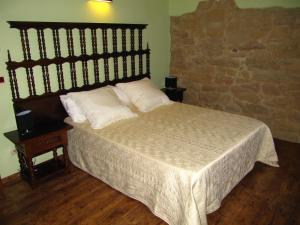 A bed or beds in a room at Ca l'Estruch