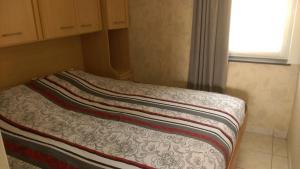 Un ou plusieurs lits dans un hébergement de l'établissement Dezaligheid