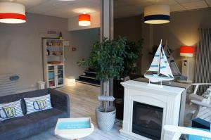 The lobby or reception area at Le Petit Vatel