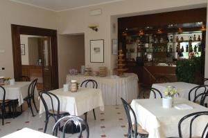 A restaurant or other place to eat at Hotel Armando' s