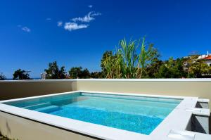 The swimming pool at or near Vila Toca