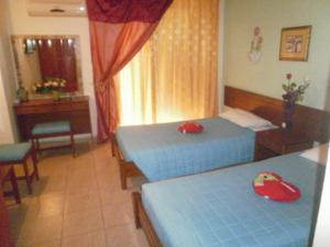 Ένα ή περισσότερα κρεβάτια σε δωμάτιο στο Tassos Apartments