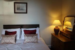 A bed or beds in a room at Brackness House Luxury B&B