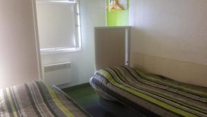Un ou plusieurs lits dans un hébergement de l'établissement hotel F1 Dunkerque Centre Saint Pol sur Mer