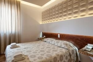 A bed or beds in a room at Elina Hotel Apartments