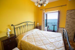 Letto o letti in una camera di Appartamento da sogno a bordo mare