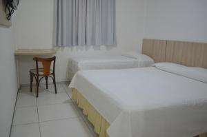 A bed or beds in a room at Annamar Hotel