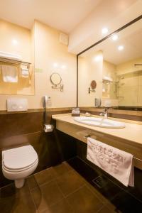 A bathroom at Grand Hotel Napoca