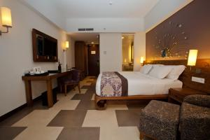 A bed or beds in a room at Sun Island Hotel & Spa Kuta