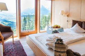 Posteľ alebo postele v izbe v ubytovaní Biohotel Grafenast