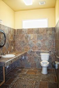 A bathroom at Whispering Palms Inn