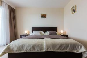 A bed or beds in a room at Villa Ljubica