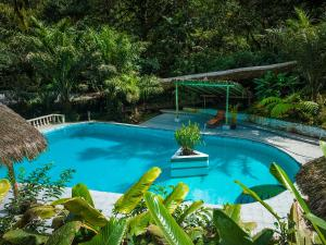 The swimming pool at or near El Septimo Paraiso