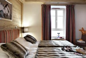 Een bed of bedden in een kamer bij CGH Résidences & Spas Kalinda