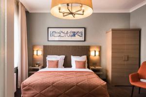Ein Bett oder Betten in einem Zimmer der Unterkunft Hotel Aragon