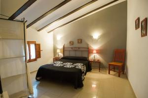 A bed or beds in a room at Complejo Rural La Belluga