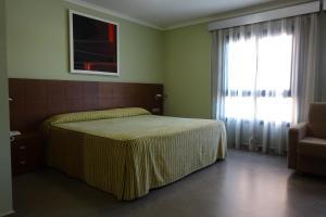 Кровать или кровати в номере Nou Avenida