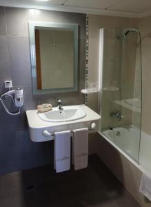 Ванная комната в Nou Avenida