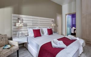 A bed or beds in a room at Villa Boutique Residence