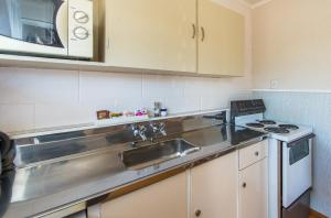A kitchen or kitchenette at Astral Motel