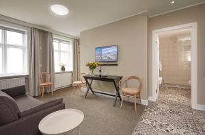Télévision ou salle de divertissement dans l'établissement Ice Apartments Reykjavik