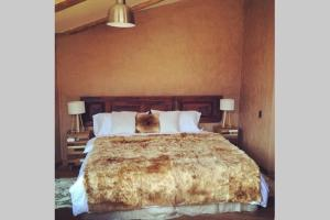 A bed or beds in a room at Luxury Villa in Urubamba, Cusco, Peru