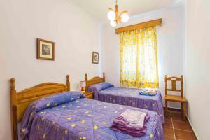 A bed or beds in a room at apartamentos Pericón