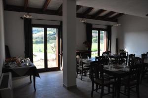 Restavracija oz. druge možnosti za prehrano v nastanitvi Agriturismo Sa Scalitta