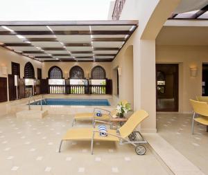 The swimming pool at or near Miramar Al Aqah Beach Resort