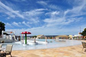 The swimming pool at or near Apartamento Flat Lacqua DiRoma