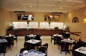 A restaurant or other place to eat at Hotel Premier