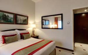 A bed or beds in a room at Ajman Hotel