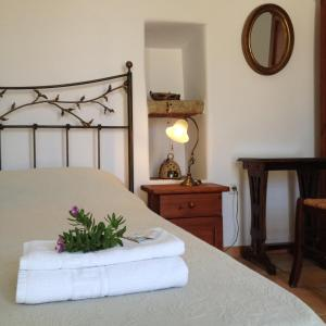 A bed or beds in a room at Villa Lemonia - Guest House