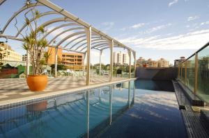 The swimming pool at or near Astor Metropole Hotel