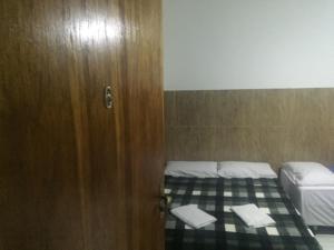 Cama ou camas em um quarto em Pousada Tilu