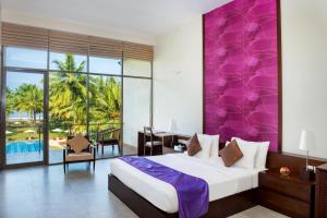 A bed or beds in a room at Taprobana by Asia Leisure