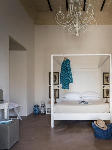 Letto o letti in una camera di Don Totu - Dimora Storica